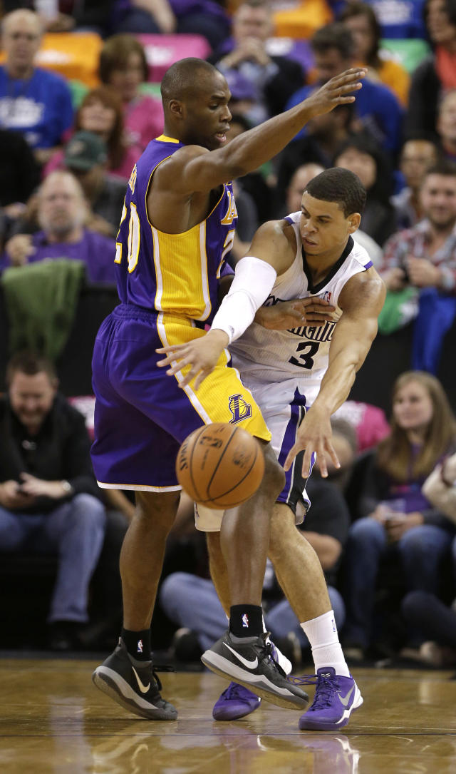 Sacramento Kings guard Ray McCallum passes as Los Angeles Lakers guard Jodie Meeks defends during the first quarter of an NBA basketball game Wednesday, April 2, 2014, in Sacramento, Calif. (AP Photo/Rich Pedroncelli)