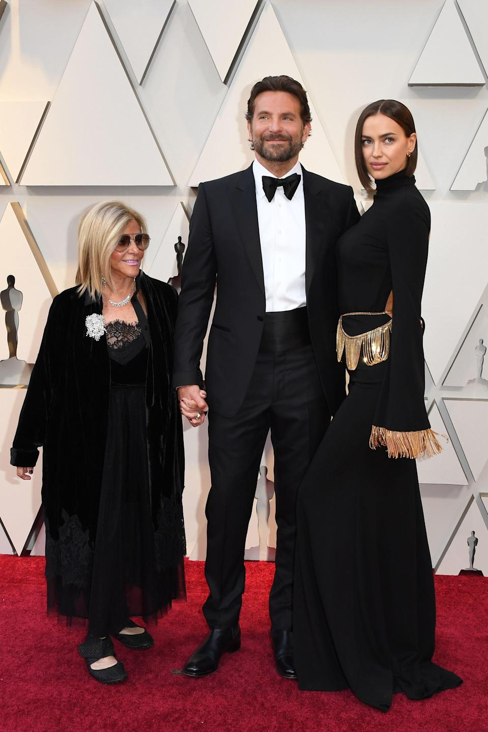 """<p>The """"A Star is Born"""" director and Best Actor nominee arrived on the red carpet with his mother, Gloria, and girlfriend, Irina Shayk. <em>[Photo: Getty]</em> </p>"""