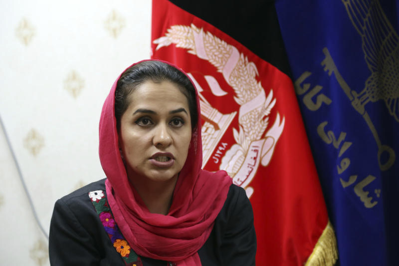 In this Oct. 15, 2019 photo, Nargis Mohmand, Kabul Municipality's spokeswoman, gives an interview to The Associated Press in Kabul, Afghanistan. Kabul, a city of some 6 million, has become one of the most polluted cities in the world, as decades of war have wrecked infrastructure and caused waves of displaced people. Authorities are trying to tackle pollution in the country's capital, which may be even deadlier than 18-year-old war. (AP Photo/Rahmat Gul)