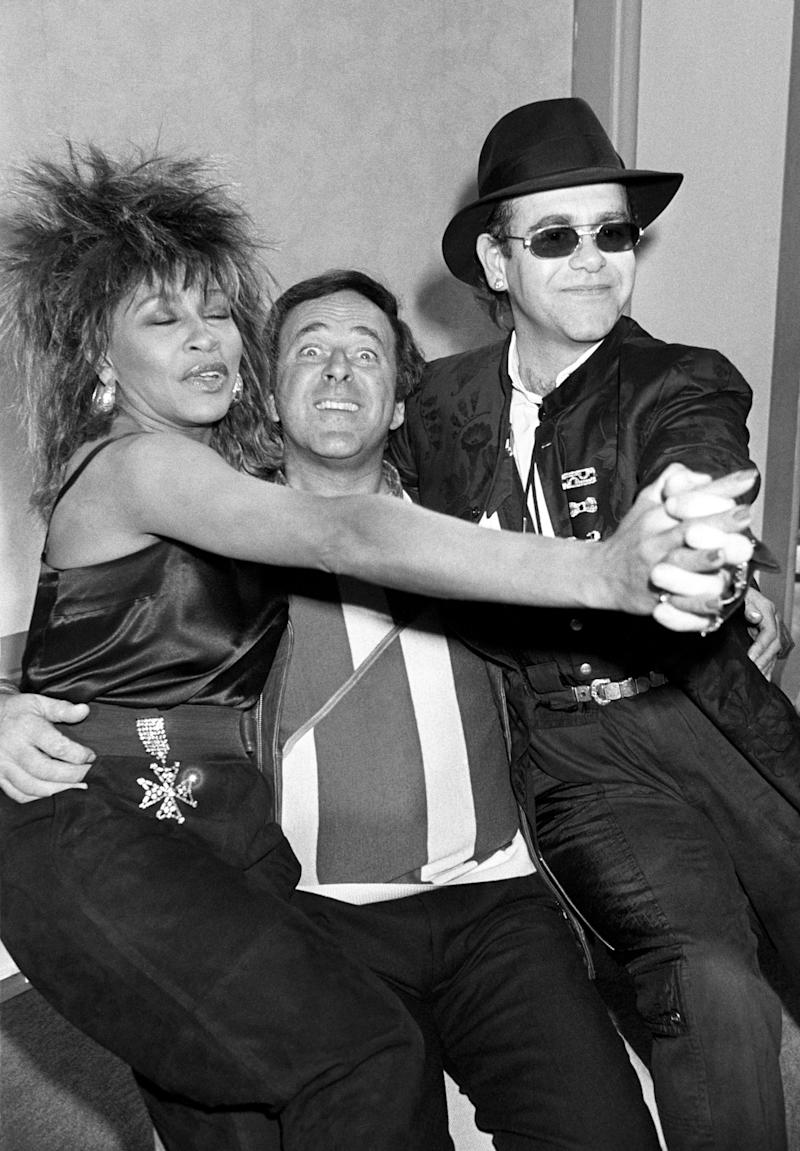 1985: Chat Show host Terry Wogan (c) with American singer Tina Turner and pop star Elton John at the BBC TV centre in Shepherds Bush, London, two of the guests for his new 3 times a week chat show series. CELEBRITY (Photo by PA Images via Getty Images)