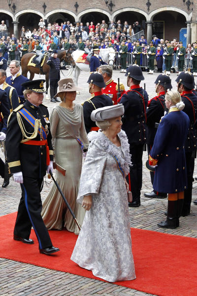 "FILE - In this Sept. 20, 2011 file photo, Dutch Queen Beatrix, center, Crown Prince Willem-Alexander, left and Princess Maxima, second left, arrive at the ""Hall of Knights"" to formally open the new parliamentary year in The Hague, Netherlands. Queen Beatrix announced she is to abdicate in favor of Crown Prince Willem Alexander during a nationally televised speech Monday, Jan. 28, 2013. Beatrix, who turns 75 on Thursday, has ruled the nation of 16 million for more than 32 years and would be succeeded by her eldest son, Crown Prince Willem-Alexander. (AP Photo/Bas Czerwinski, File)"