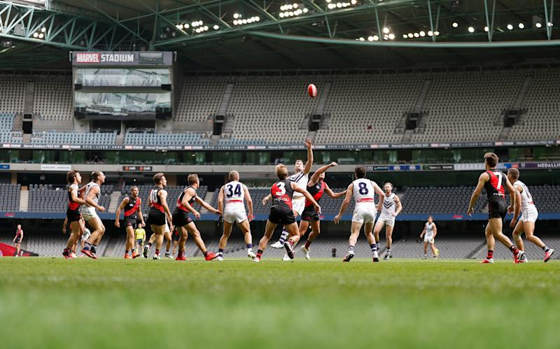 MELBOURNE, AUSTRALIA - MARCH 21: A general view as empty seats are seen due to the coronavirus outbreak during the 2020 AFL Round 01 match between the Essendon Bombers and the Fremantle Dockers at Marvel Stadium on March 21, 2020 in Melbourne, Australia. (Photo by Michael Willson/AFL Photos via Getty Images)