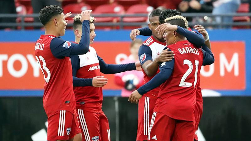 Pictured here, FC Dallas players during a 2019 game.