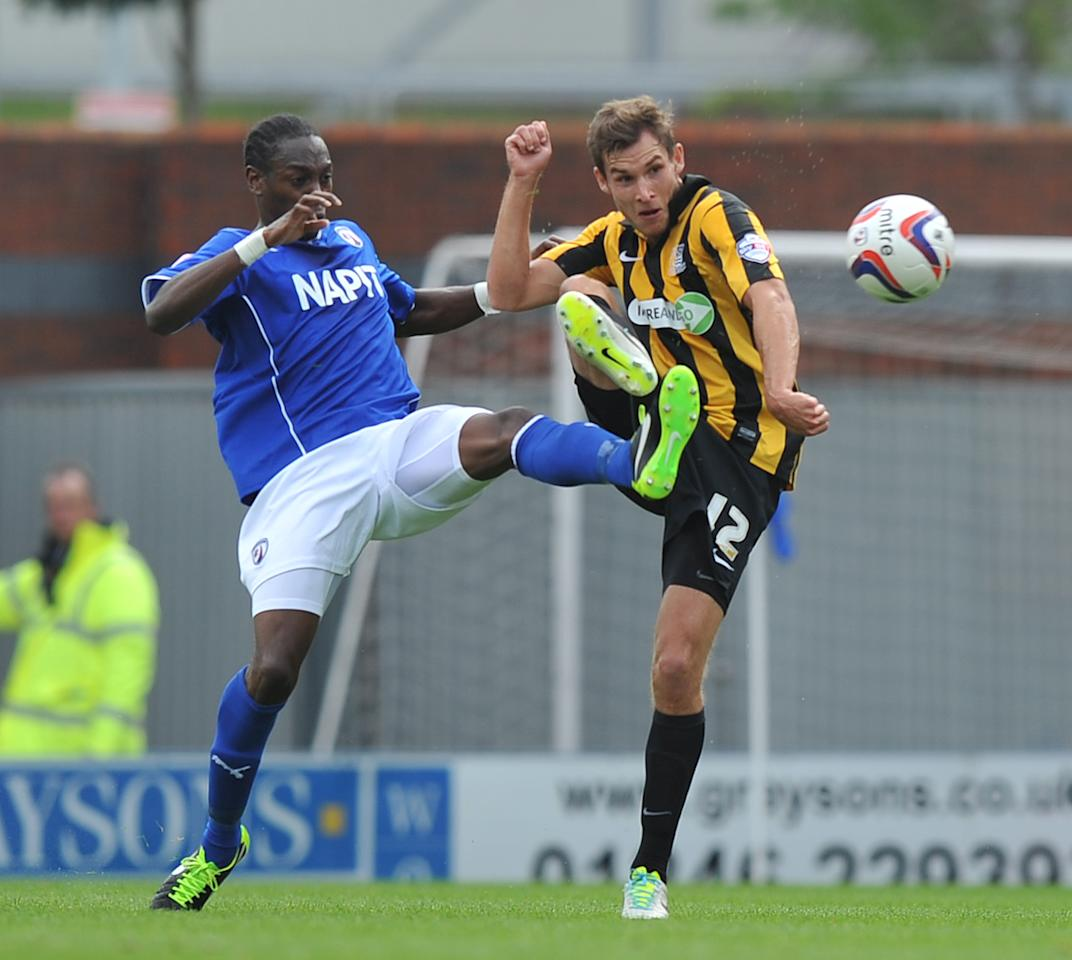 Southend United's Will Atkinson and Chesterfield's Nathan Smith battle for the ball during the Sky Bet Football League Two match at the Proact Stadium, Chesterfield.