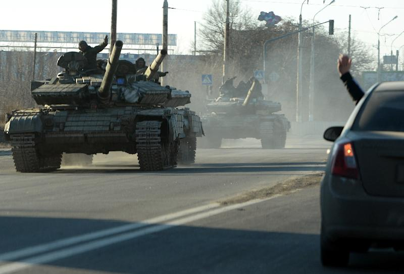 Pro-Russian separatists ride tanks in the eastern Ukrainian city of Lugansk on February 21, 2015
