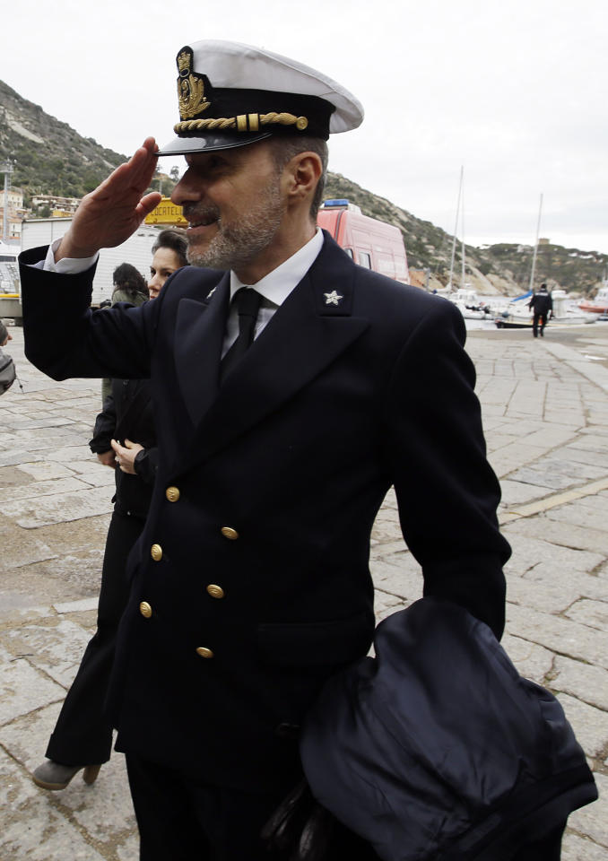 Italian Coast Guard Capt. Gregorio De Falco salutes as he arrives on the Tuscan Island Isola del Giglio, Italy, Sunday, Jan. 13, 2013. De Falco was heard ordering the captain, who had abandoned the ship with his first officers, back on board to oversee the evacuation. But Capt. Francesco Schettino resisted the order, saying it was too dark and the ship was tipping dangerously. Survivors of the Costa Concordia shipwreck and relatives of the 32 people who died marked the first anniversary of the grounding Sunday. (AP Photo/Gregorio Borgia)