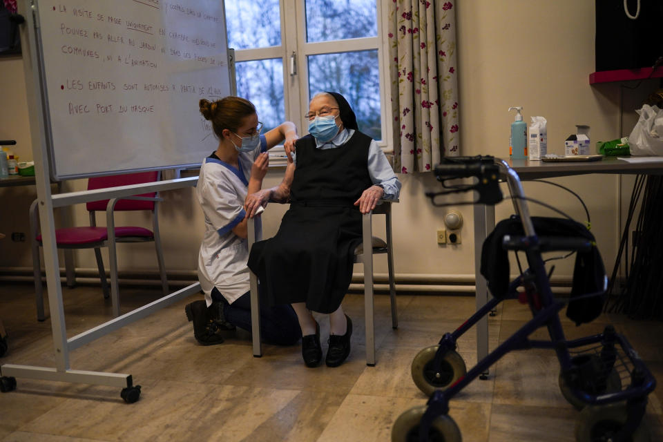 FILE - In this Thursday, Jan. 7, 2021 file photo, a nurse administers the Pfizer/Biontech COVID-19 vaccine to a nun at the CHC Landenne care home in Landenne-sur-Meuse, Belgium. Vaccination programs in the 27 nation-bloc have gotten off to a slow start and some EU members have been quick to blame the EU's executive arm for a perceived failure of delivering the right amount of doses. (AP Photo/Francisco Seco, File)