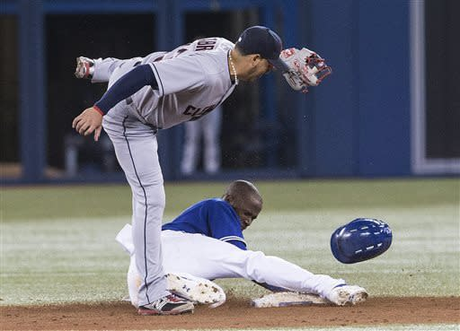 Toronto Blue Jays' Jose Reyes steals second base in front Cleveland Indians' Asdrubal Cabera during the fifth inning of a baseball game in Toronto on Thursday, April 4, 2013. (AP Photo/The Canadian Press, Chris Young)
