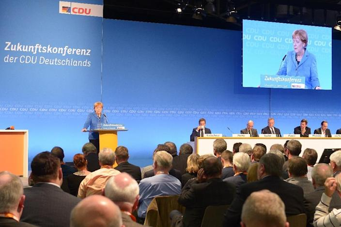 German Chancellor Angela Merkel addresses a meeting of the local branch of her Christian Democrats in Schkeuditz on October 14, 2015 (AFP Photo/Peter Endig)