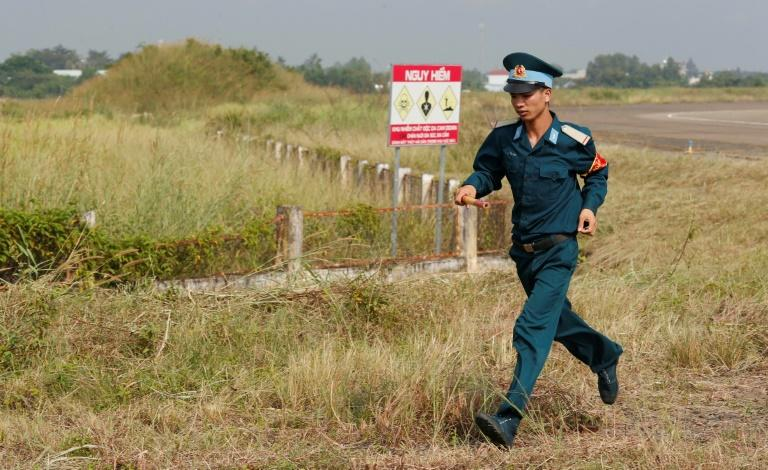 A Vietnamese soldier runs past the dioxin contaminated area on Bien Hoa airbase
