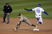 Los Angeles Dodgers' Mookie Betts (50) is forced out at second base by San Diego Padres second baseman Jake Cronenworth after a ground ball by Justin Turner during the first inning of a baseball game Thursday, April 22, 2021, in Los Angeles. (AP Photo/Marcio Jose Sanchez)