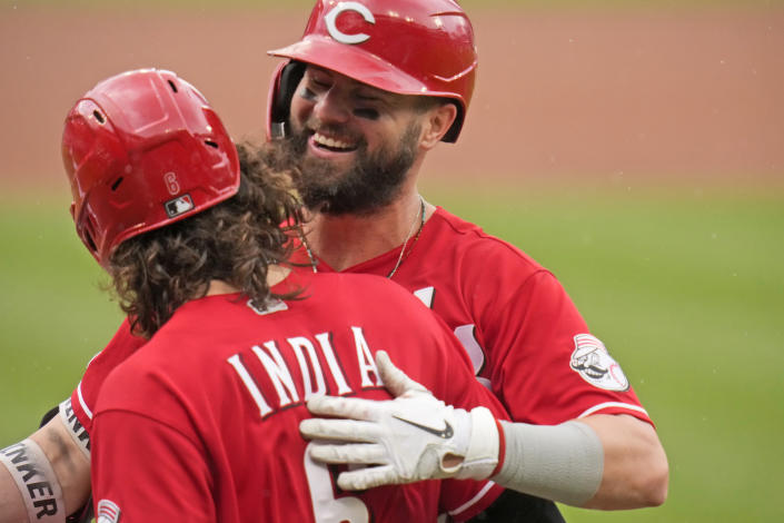 Cincinnati Reds' Jesse Winker, right, gets a hug from teammate Jonathan India after hitting a two-run home run during the first inning of a baseball game against the St. Louis Cardinals Sunday, June 6, 2021, in St. Louis. (AP Photo/Jeff Roberson)