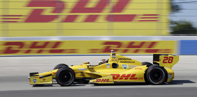 Ryan Hunter-Reay makes his way through Turn 4 during the Milwaukee Mile IndyCar auto race Sunday, Aug. 17, 2014, in West Allis, Wis. (AP Photo/Morry Gash)