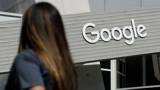 PHOTO: A woman walks past a sign at the Google campus in Mountain View, Calif., September 24, 2019 (Jeff Chiu / AP, FILE)