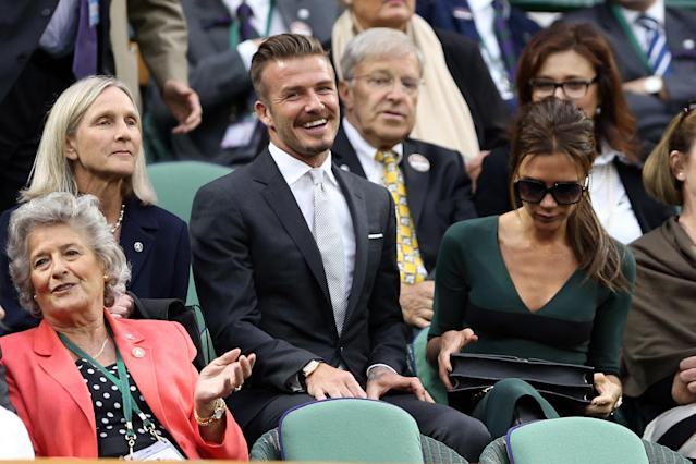 LONDON, ENGLAND - JULY 08: David Beckham and Victoria Beckham sit in the Royal Box during the Gentlemen's Singles final match between Roger Federer of Switzerland and Andy Murray of Great Britain on day thirteen of the Wimbledon Lawn Tennis Championships at the All England Lawn Tennis and Croquet Club on July 8, 2012 in London, England. (Photo by Clive Brunskill/Getty Images)