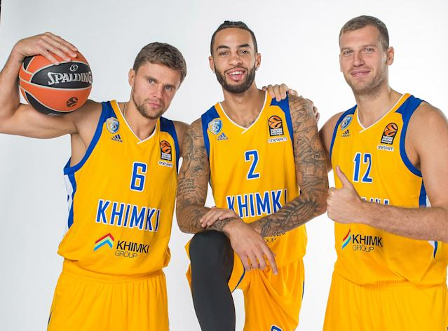 Tyler Honeycutt poses with two BC Khimki teammates last September in Moscow. (Getty Images)