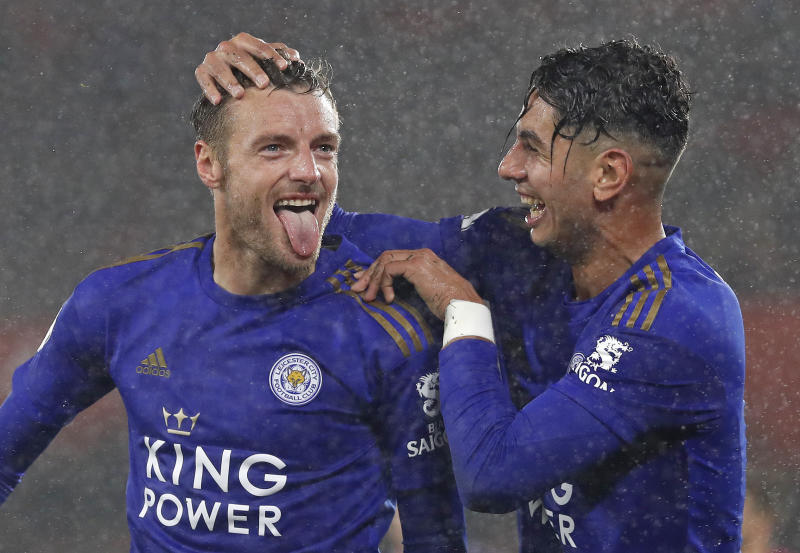 Leicester's Jamie Vardy, left, celebrates with Ayoze Perez after scoring his side's fifth goal during the English Premier League soccer match between Southampton and Leicester City at St Mary's stadium in Southampton, England Friday, Oct., 25, 2019. (AP Photo/Alastair Grant)