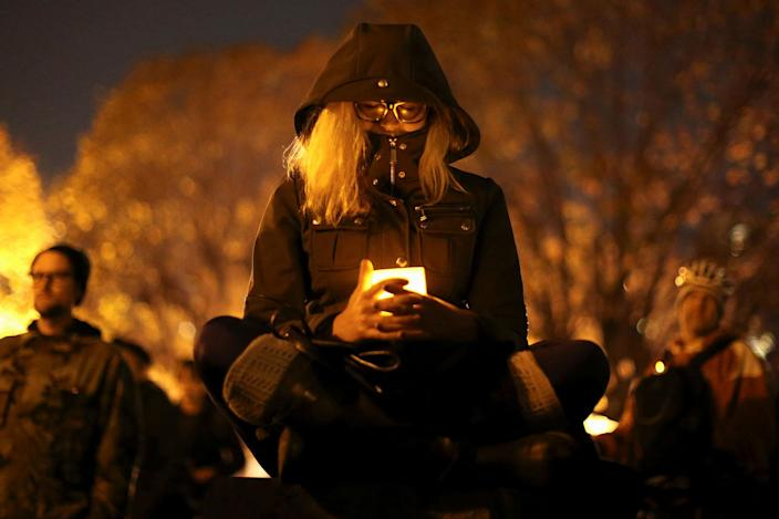 <p>DEC. 5, 2016 — A woman holds a candle at a vigil for the victims of the fatal warehouse fire in Oakland, California. (Lucy Nicholson/Reuters) </p>