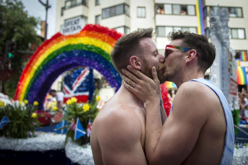 A couple kissed after getting engaged during the Capital Pride Parade in Washington on Saturday June 8, 2019. (Photo: Caroline Brehman/CQ Roll Call)