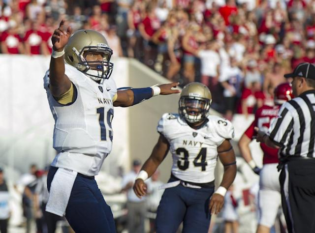 Navy quarterback Keenan Reynolds (19) reacts after scoring a touchdown against Indiana during the first half of an NCAA college football game, Saturday, Sept. 7, 2013, in Bloomington, Ind. (AP Photo/Doug McSchooler)