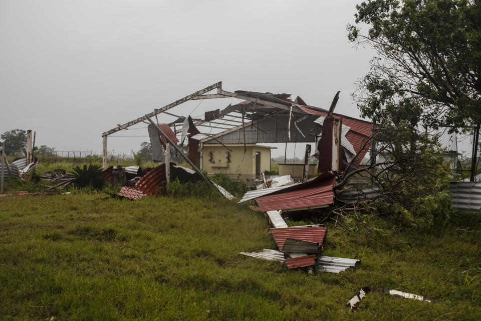 Pieces of roof lay on the ground in the aftermath of Hurricane Grace, in Tecolutla, Veracruz State, Mexico, Saturday, Aug. 21, 2021. Grace hit Mexico's Gulf shore as a major Category 3 storm before weakening on Saturday, drenching coastal and inland areas in its second landfall in the country in two days. (AP Photo/Felix Marquez)