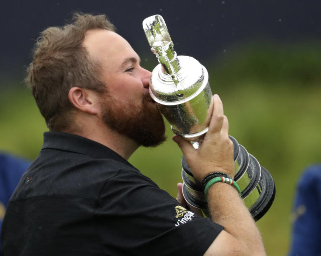 Ireland's Shane Lowry holds and kisses the Claret Jug trophy after winning the British Open Golf Championships at Royal Portrush in Northern Ireland, Sunday, July 21, 2019.(AP Photo/Peter Morrison)
