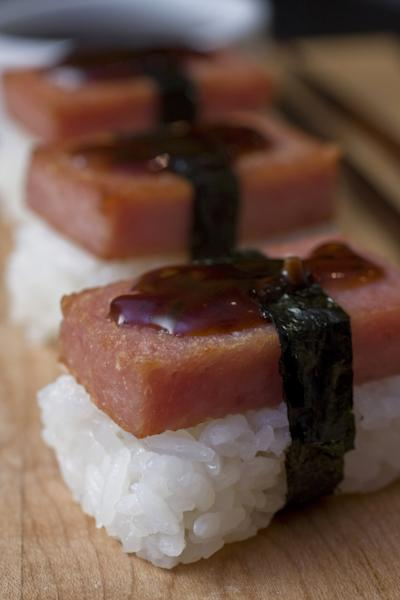 FILE - This Feb. 9, 2009 file photo shows Spam musubi, the popular canned lunch meat atop a block of rice, wrapped with nori (edible seaweed) with soy sauce, in Concord, N.H. Cans of Spam have become a common item that's being stolen from Honolulu stores and then sold on the streets for quick cash, according to authorities. Hawaii's love affair with Spam began during World War II, when rationing created just the right conditions for the rise of a meat that needs no refrigeration and has a remarkably long shelf life (indefinitely, the company says). (AP Photo/Larry Crowe, File)