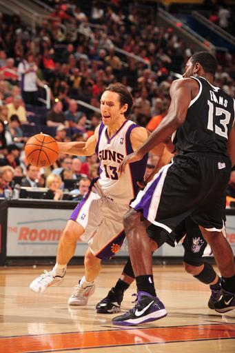 PHOENIX, AZ - MARCH 4: Steve Nash #13 of the Phoenix Suns drives against Tyreke Evans #13 of the Sacramento Kings in an NBA game played on March 4, 2012 at U.S. Airways Center in Phoenix, Arizona. (Photo by Barry Gossage/NBAE via Getty Images)