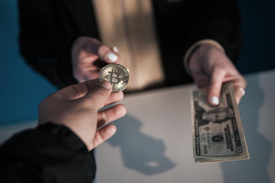 Spending a digital currency in a physical store, restaurant, or hotel requires a workaround. (Photo: Getty)