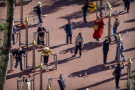 Members of the public do their morning exercises at a public park in Lhasa in western China's Tibet Autonomous Region, as seen during a rare government-led tour of the region for foreign journalists, Tuesday, June 1, 2021. Long defined by its Buddhist culture, Tibet is facing a push for assimilation and political orthodoxy under China's ruling Communist Party. (AP Photo/Mark Schiefelbein)