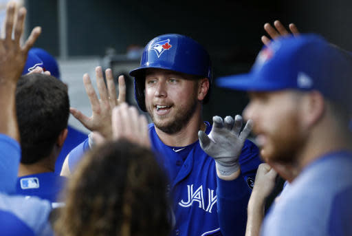 Toronto Blue Jays' Justin Smoak high-fives teammates in the dugout after hitting a solo home run in the first inning of a baseball game against the Baltimore Orioles, Wednesday, Aug. 29, 2018, in Baltimore. (AP Photo/Patrick Semansky)
