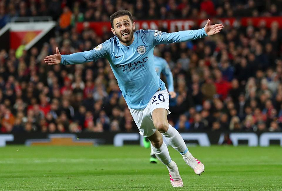 Bernardo Silva of Manchester City celebrates after scoring his team's first goal during the Premier League match between Manchester United and Manchester City.