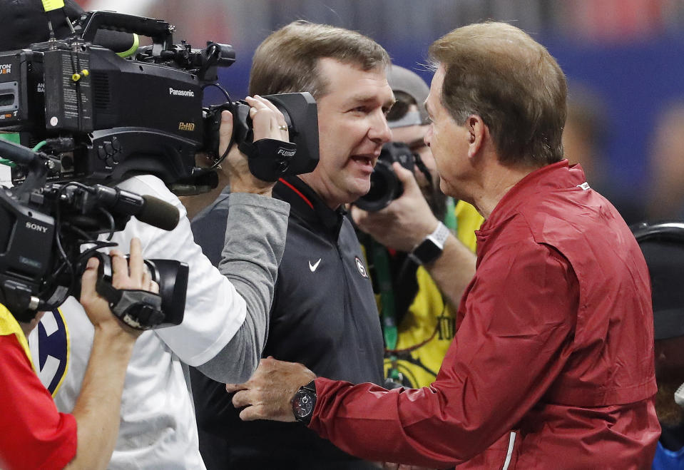 Georgia head coach Kirby Smart, left, speaks with Alabama head coach Nick Saban ahead of the Southeastern Conference championship NCAA college football game between Georgia and Alabama, Saturday, Dec. 1, 2018, in Atlanta. (AP Photo/John Bazemore)