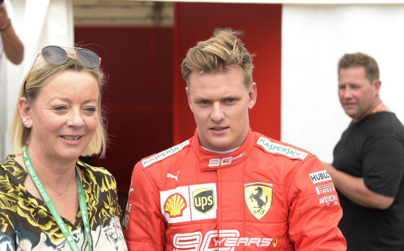 Germany's Mick Schumacher, son of Michael, stands after driving his father's Ferrari F2004 at the Hockenheimring racetrack in Hockenheim, Germany, Saturday, July 27, 2019. The German Formula One Grand Prix will be held on Sunday. (AP Photo/Jens Meyer)
