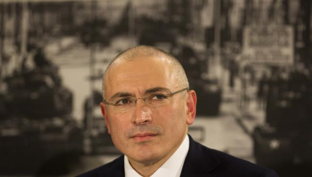 Mikhail Khodorkovsky attends his first news conference after his release in Berlin, Sunday, Dec. 22, 2013. The former oil baron and prominent critic of Russian President Vladimir Putin, Mikhail Khodorkovsky, was reunited with his family in Berlin on Saturday, a day after being released from a decade-long imprisonment in Russia. (AP Photo/Markus Schreiber)