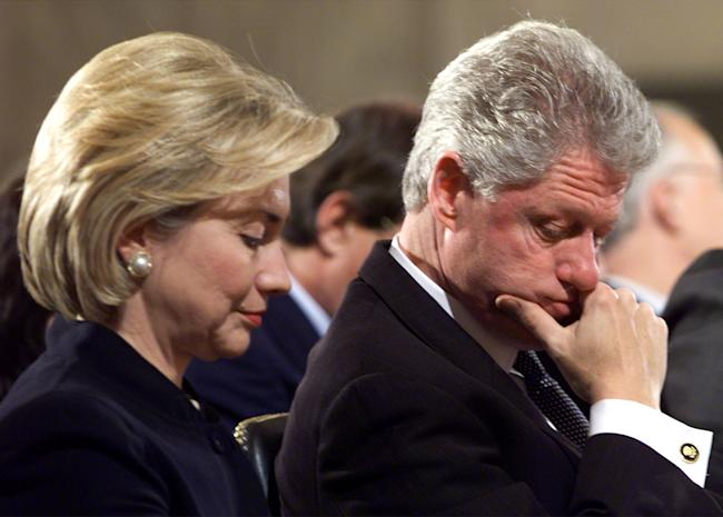US President Bill Clinton looks over to his wife Hillary January 28, during a memorial service on Capitol Hill for Lawton Chiles, a former senator who was governor of florida when he died in December. The impeachment trial of Clinton in the Senate is temporarily on hold as senators attempt to work out the details of deposing witnesses.