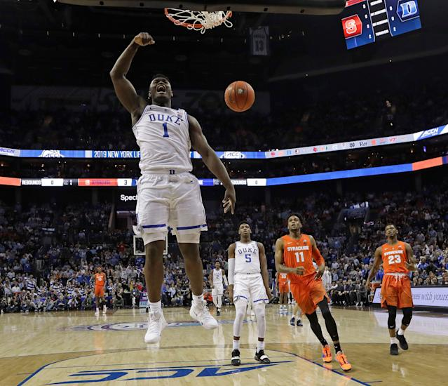 "Duke's <a class=""link rapid-noclick-resp"" href=""/ncaab/players/147096/"" data-ylk=""slk:Zion Williamson"">Zion Williamson</a> (1) reacts after his dunk against Syracuse during the first half of an NCAA college basketball game in the Atlantic Coast Conference tournament in Charlotte, N.C., Thursday, March 14, 2019. (AP Photo/Chuck Burton)"