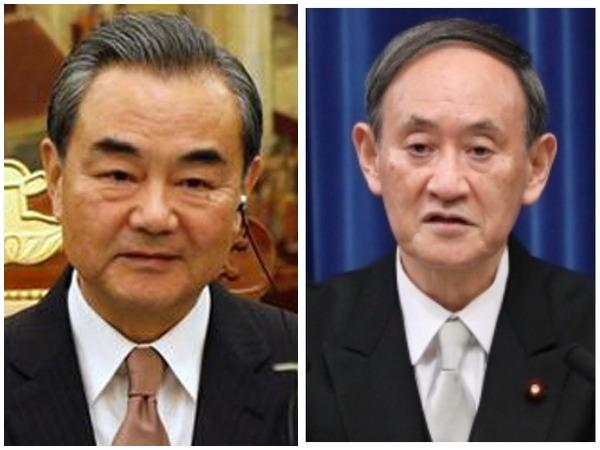 Chinese Foreign Minister Wang Yi and Japanese Prime Minister Yoshihide Suga