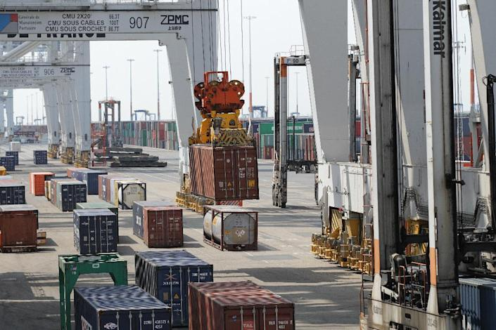 Containers are loaded at the port of Le Havre in France in July 2014. The volume of cargo handled by the new China-Russian port will be comparable to the French hub (AFP Photo/Charly Triballeau)