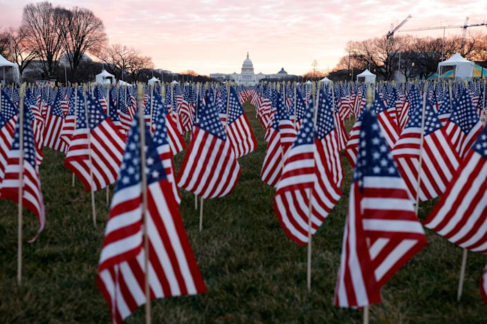 Thousands of U.S. flags are seen at the National Mall as part of a memorial paying tribute to people across the country who have died from the coronavirus, near the U.S. Capitol ahead of President-elect Joe Biden's inauguration, in Washington, on January 18, 2021. / Credit: Carlos Barria / Reuters