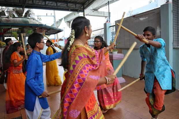 Telugu youths perform during the Ugadhi celebrations at a temple in Puchong last Saturday.
