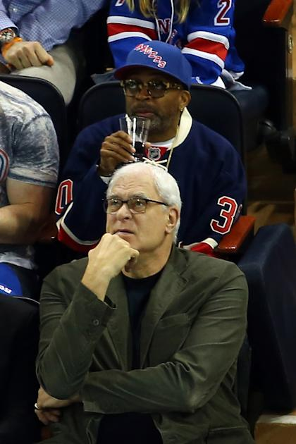 Phil Jackson and Spike Lee scout hockey players. (Photo by Elsa/Getty Images)