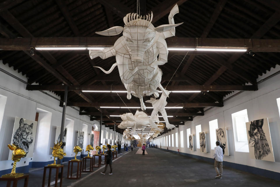 """Dissident Chinese artist Ai Weiwei's work on display during a press preview of his new exhibition """"Rapture"""" in Lisbon, Thursday, June 3, 2021. The world-renowned artist is putting on the biggest show of his career, and he is doing it in a place he's fallen in love with: Portugal. (AP Photo/Armando Franca)"""