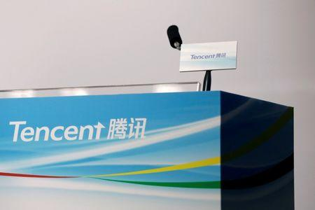 FILE PHOTO: Logos of Tencent are displayed at a news conference in Hong Kong, China March 22, 2017. REUTERS/Tyrone Siu/File Photo