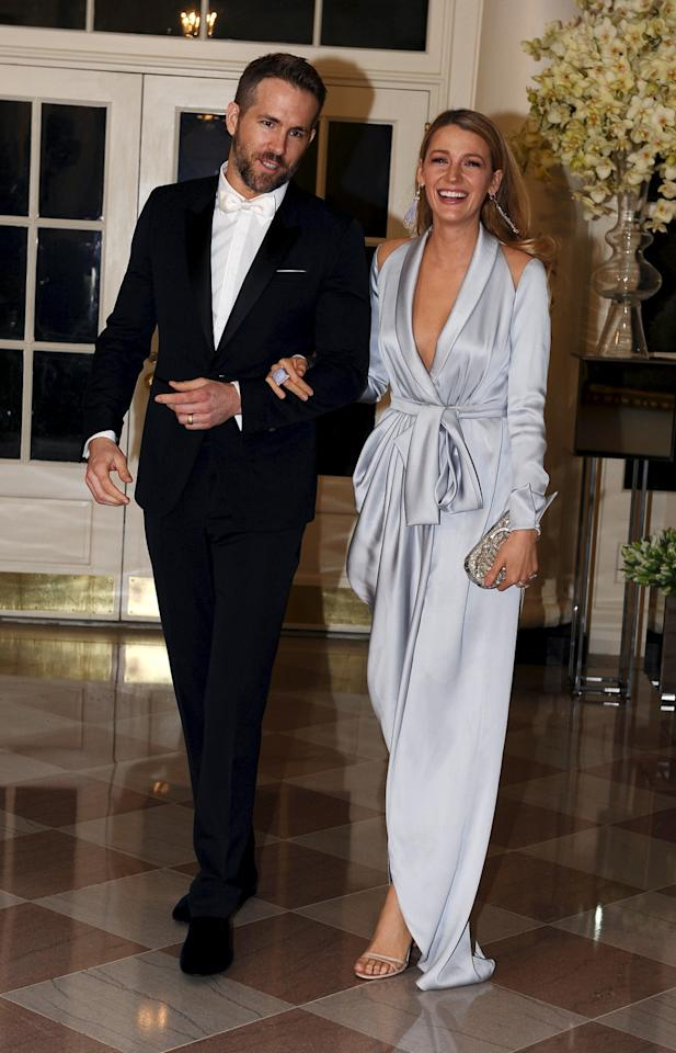 <p>Blake Lively, who famously doesn't use a stylist, proved she definitely doesn't need one when she showed up to the White House wearing a robe-like gown from Ralph & Russo. The silk number could easily have been mistaken for bathroom wear, but her sartorial prowess made it appropriate for the black-tie affair. The California actress accompanied her Vancouver-born husband, Ryan Reynolds, who was wearing in Burberry for the occasion. (<i><i>Photo: Reuters)</i></i></p>