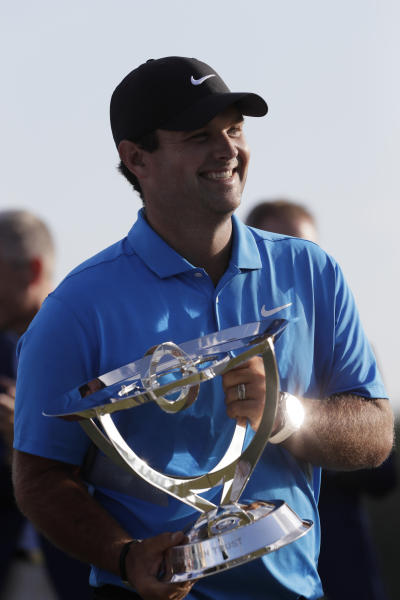 Patrick Reed holds the FedEx Cup Trophy after winning the Northern Trust golf tournament at Liberty National Golf Course, Sunday, Aug. 11, 2019, in Jersey City, N.J. (AP Photo/Mark Lennihan)