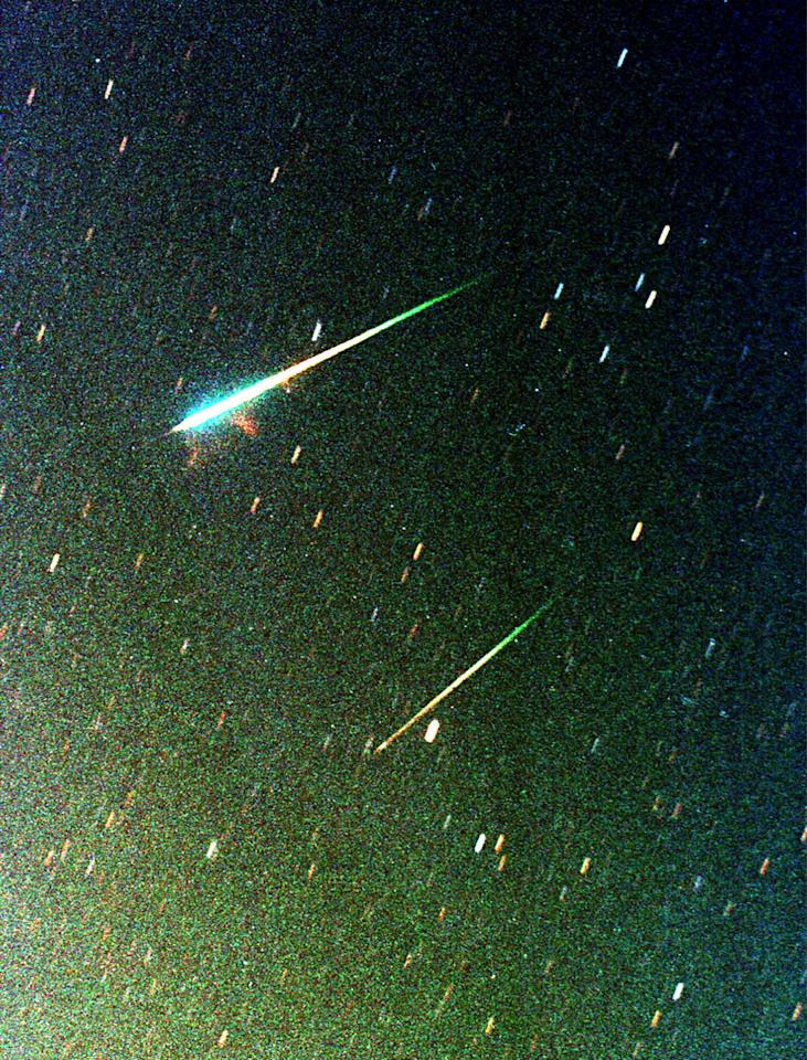 Meteors are visible from the Prince Hamaza Camp, an observation site for the Leonid meteor shower, in the Azraq desert 100km from Amman November 19, 2002. The meteors, visible from Europe and North America, should have been the biggest shooting star display of the 21st century. However, the full moon thwarted many star gazers from enjoying the spectacle. REUTERS/Ali Jarekji