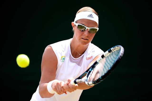 LONDON, ENGLAND - JULY 01: Kirsten Flipkens of Belgium plays a backhand during her Ladies' Singles fourth round match against Flavia Pennetta of Italy on day seven of the Wimbledon Lawn Tennis Championships at the All England Lawn Tennis and Croquet Club on July 1, 2013 in London, England. (Photo by Dennis Grombkowski/Getty Images)