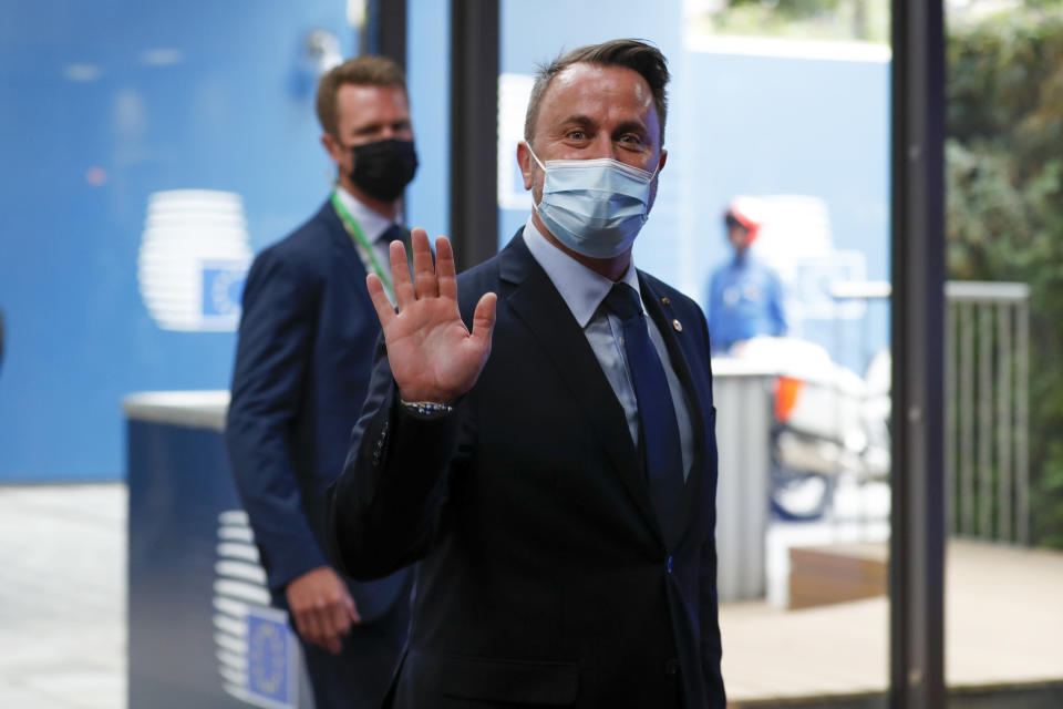 Luxembourg's Prime Minister Xavier Bettel arrives for an EU summit at the European Council building in Brussels, Thursday, June 24, 2021. At their summit in Brussels, EU leaders are set to take stock of coronavirus recovery plans, study ways to improve relations with Russia and Turkey, and insist on the need to develop migration partners with the countries of northern Africa, but a heated exchange over a new LGBT bill in Hungary is also likely. (Johanna Geron/Pool Photo via AP)