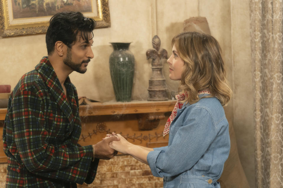 """This image released by CBS shows Utkarsh Ambudkar, left, and Rose McIver in a scene from the comedy series """"Ghosts."""" (Cliff Lipson/CBS via AP)"""